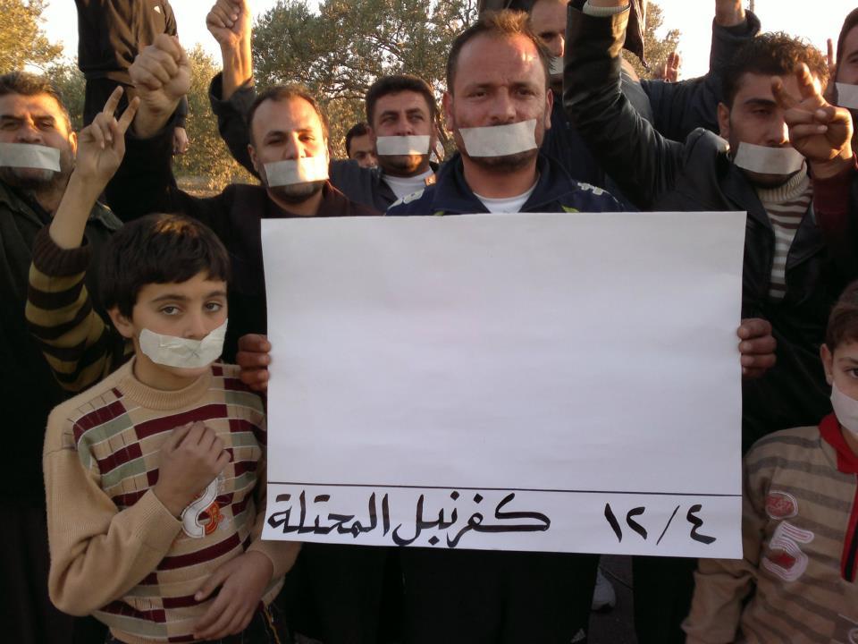"""""""كفرنبل"""" السوريّة تكتب التاريخ الدامي…بقلم تخطيط وابتسامة"""