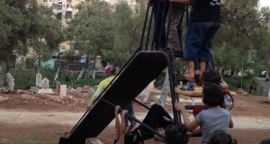 Child's Play in Aleppo Graveyard